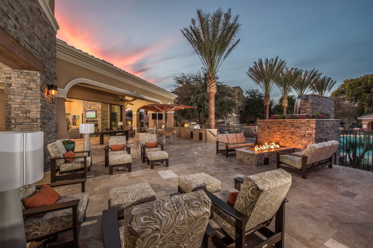 Beautifully architected outdoor common area with fire pit and lounge seating at Stone Oaks, a Mark-Taylor luxury community