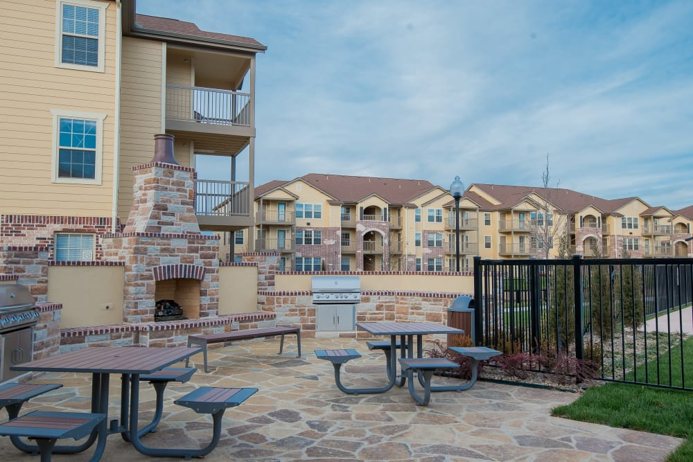 Outdoor tables at Portico at Friars Creek Apartments in Temple, Texas