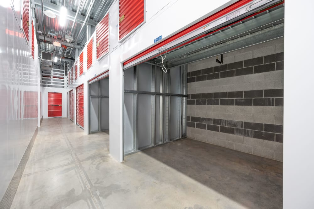 Large indoor storage units with the doors open at Trojan Storage of Commerce in Commerce, California