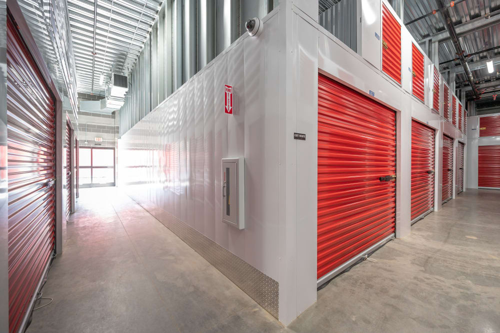 Indoor hallway access to storage units at Trojan Storage of Commerce in Commerce, California