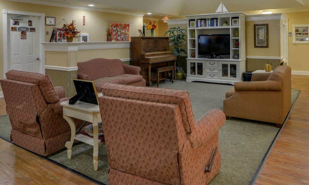 Entertainment room with comfortable seating at Azalea Court Senior Living in Smyrna, Tennessee