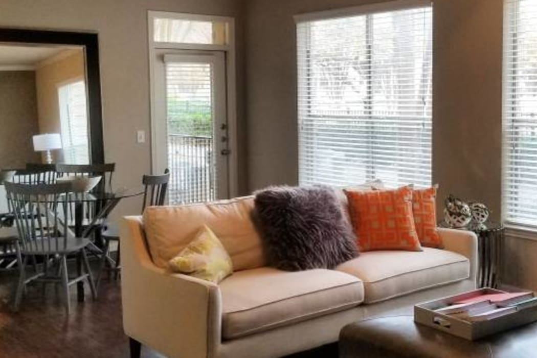Naturally well-lit living room at Ridgecrest Apartment Homes in Austin, Texas