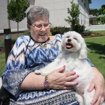Woman with a dog at Prairie House Assisted Living and Memory Care in Broken Arrow, Oklahoma