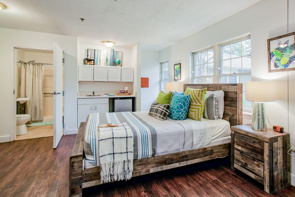Beautiful hardwood floors and layout in model bedroom at Wood Haven Senior Living in Tewksbury, Massachusetts