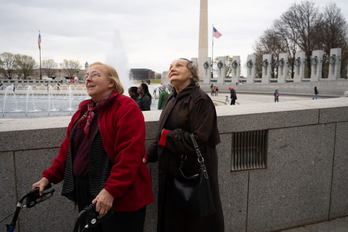 Two female residents at the WWII memorial in Washington, DC