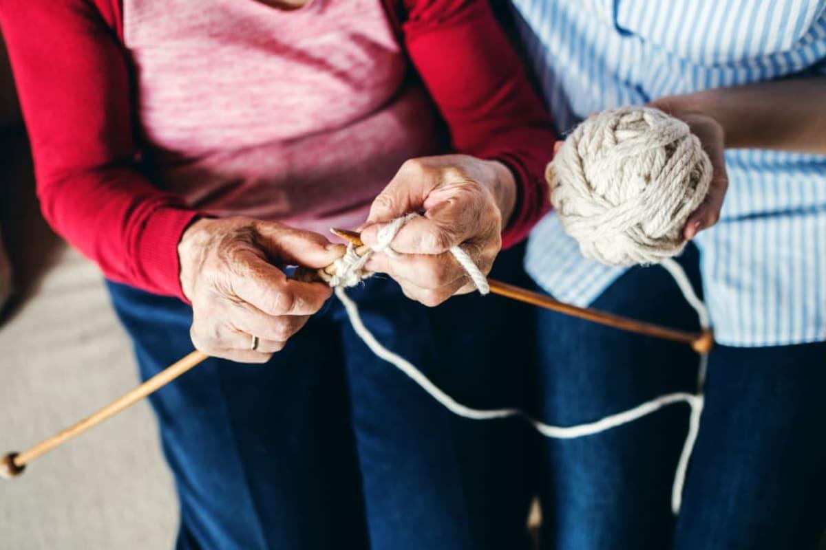 Two residents knitting at Madison House in Norfolk, Nebraska