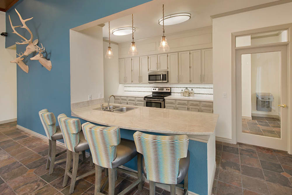 Dining room with a living room view at Cortland Village Apartment Homes in Hillsboro, Oregon