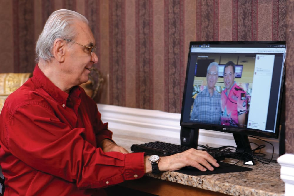 man browsing internet at Gardenview in Calumet, Michigan