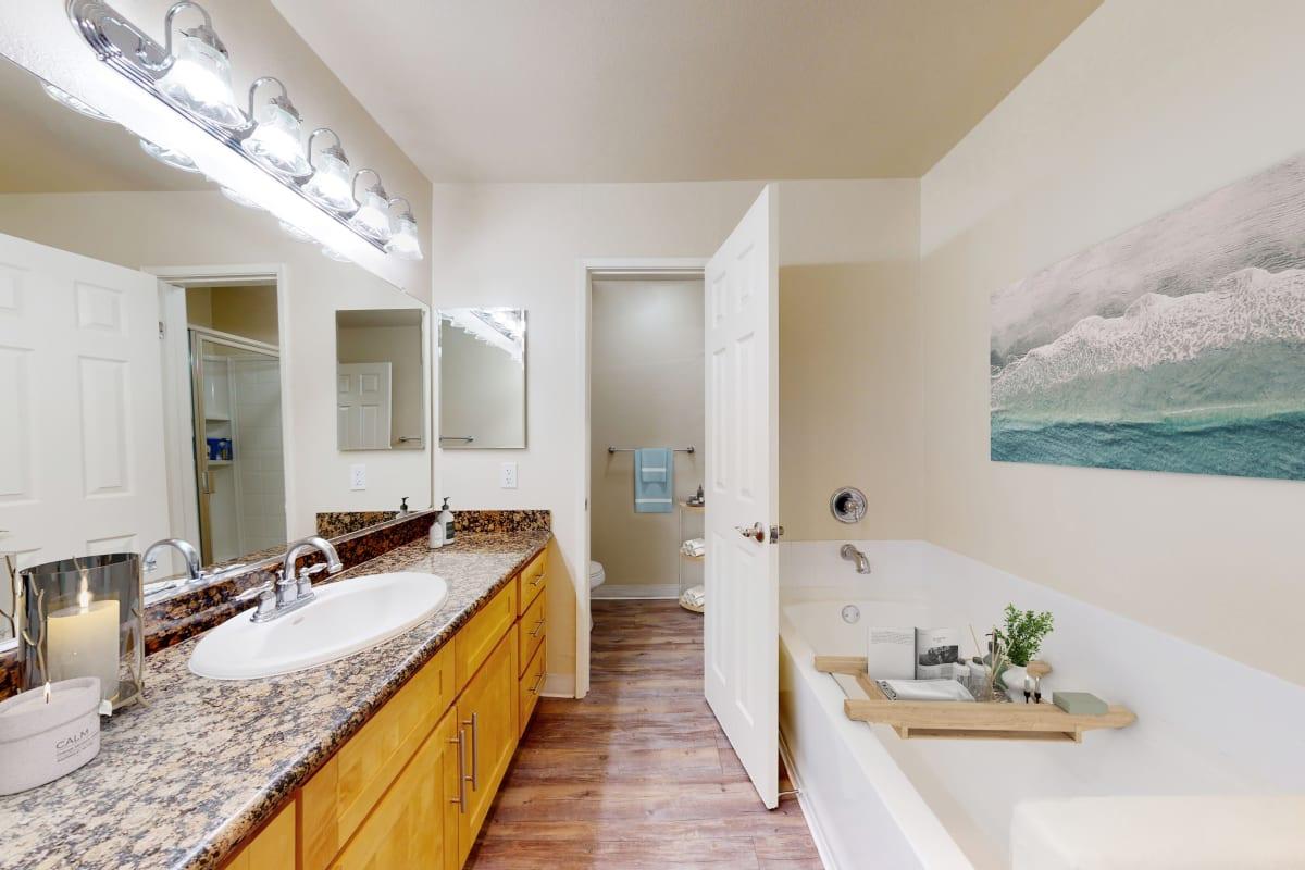 Bathroom with large vanity and soak tub at Waters Edge at Marina Harbor in Marina del Rey, California
