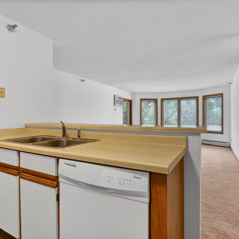 Kitchen and Living Area at Oaks Lincoln Apartments & Townhomes in Edina, Minnesota