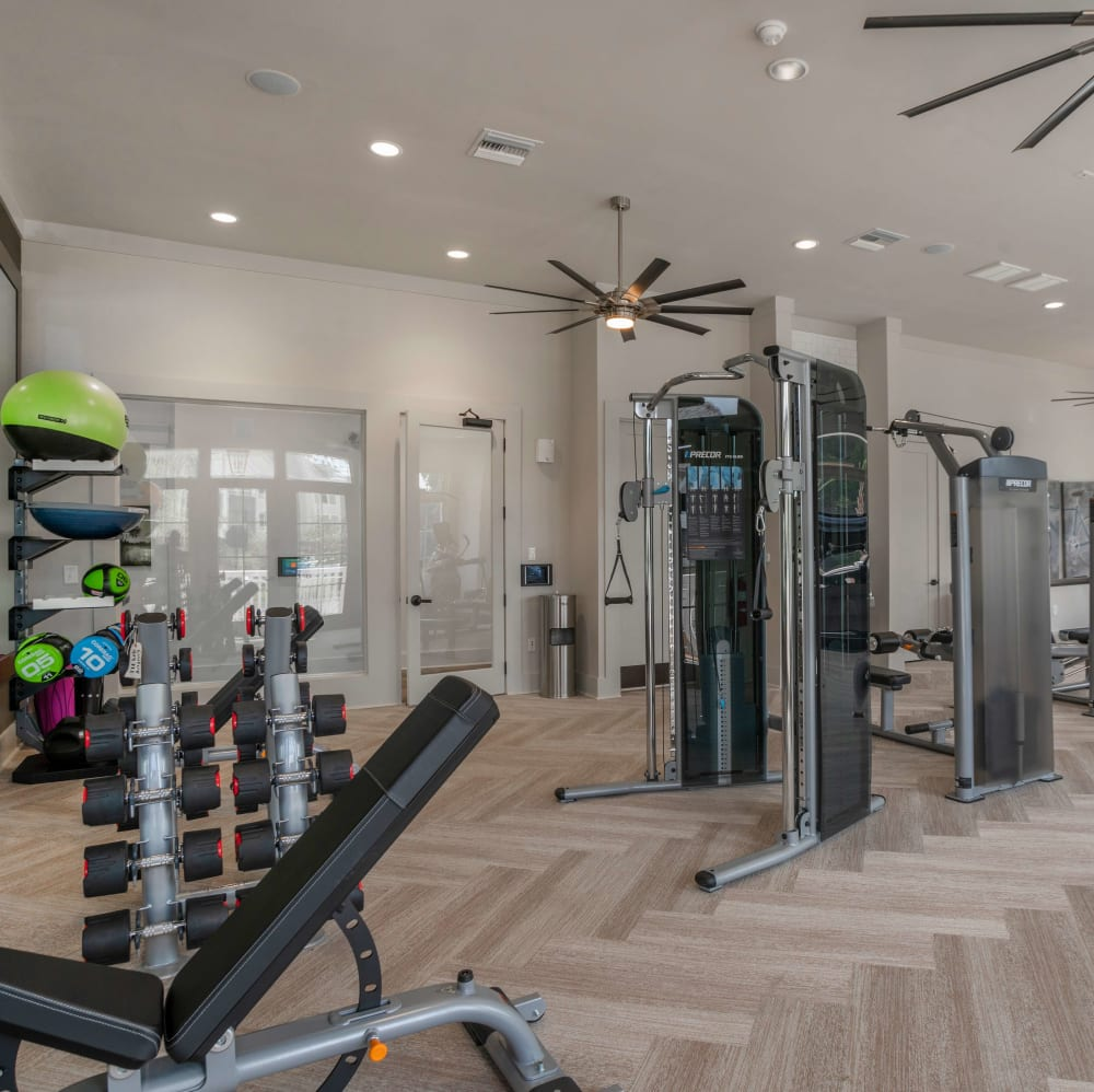 Fitness center with individual work stations at Elevate at Brighton Park in Summerville, South Carolina