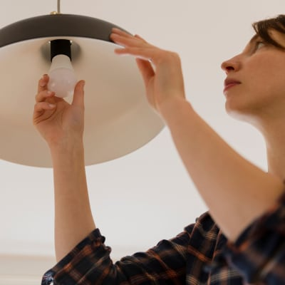 Resident changing changing out light bulb