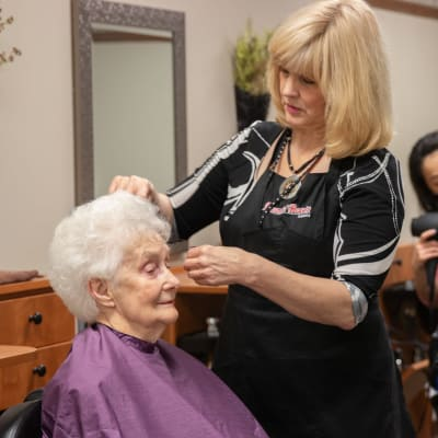 Resident getting her hair done at a salon in a Ebenezer Senior Living community