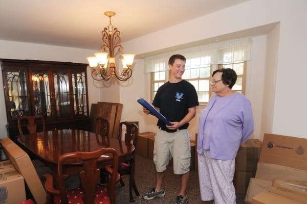 Virginia Varsity Transfer & Storage employee explains an estimate in Salem, Virginia