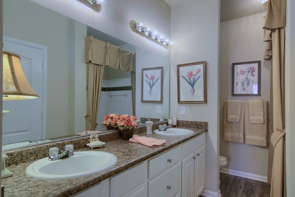 Bathroom with dual sinks at Reserve at Long Point in Hattiesburg, Mississippi