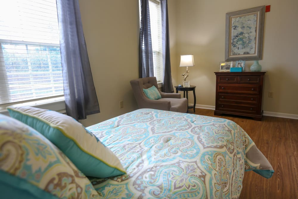 A spacious, decorated bedroom at Harmony at Chantilly in Herndon, Virginia