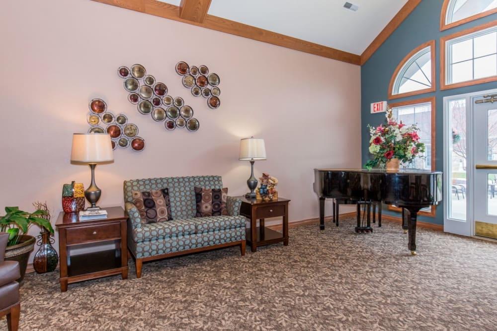 Sitting area complete with piano at Brookstone Estates of Tuscola in Tuscola, Illinois
