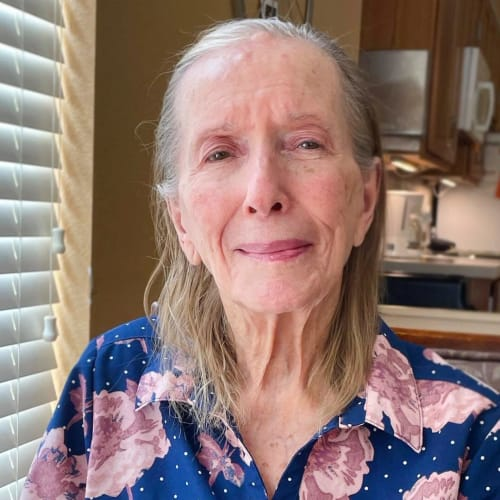 Smiling resident at Oxford Glen Memory Care at Sachse in Sachse, Texas