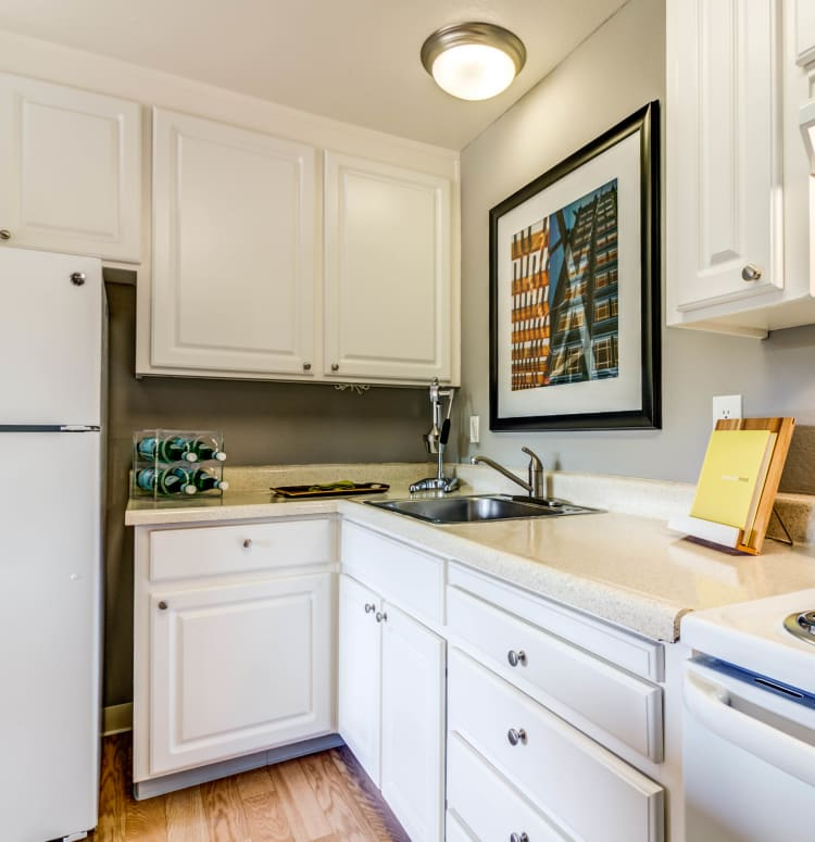 Modern kitchen with plenty of cupboard space for storage in a model home at The Landmark Apartment Homes in Sunnyvale, California