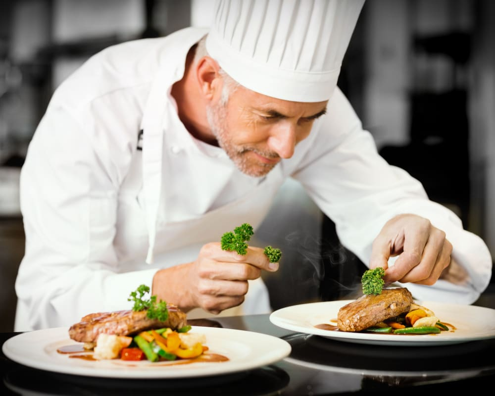 Chef preparing a meal at WellQuest of Elk Grove in Elk Grove, California