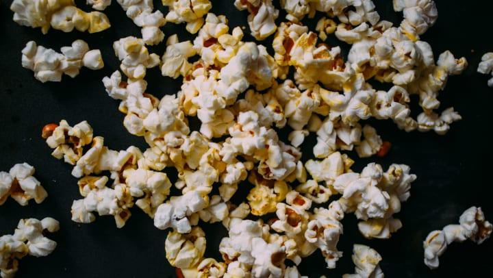 Popcorn spread over a table in a blog article on our website at Olympus Boulevard in Frisco, Texas.