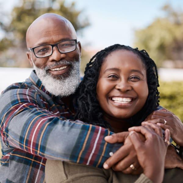 A resident and daughter hugging at Kenmore Senior Living in Kenmore, Washington.