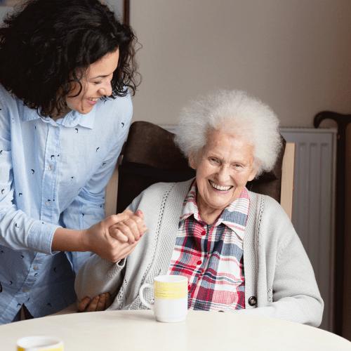 Resident and caregiver at Pinnacle Senior Living
