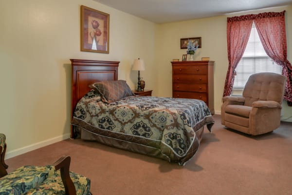 Assisted living apartment bedroom at Azalea Court Senior Living in Smyrna, Tennessee