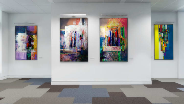 Colorful abstract paintings on display at a gallery near Olympus at Daybreak in South Jordan, Utah