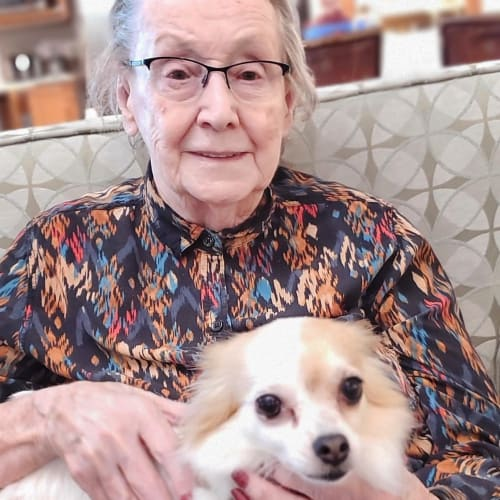 Resident with her dog at Glen Carr House Memory Care in Derby, Kansas