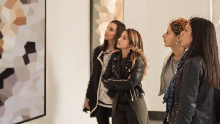 Women admiring abstract paintings at The Leonardo, an art gallery near Olympus at Daybreak in South Jordan, Utah