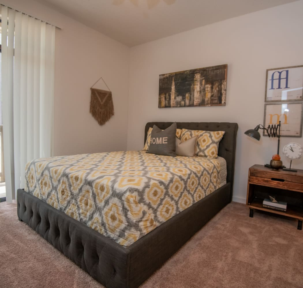 A well decorated bedroom at The Trace of Ridgeland in Ridgeland, Mississippi