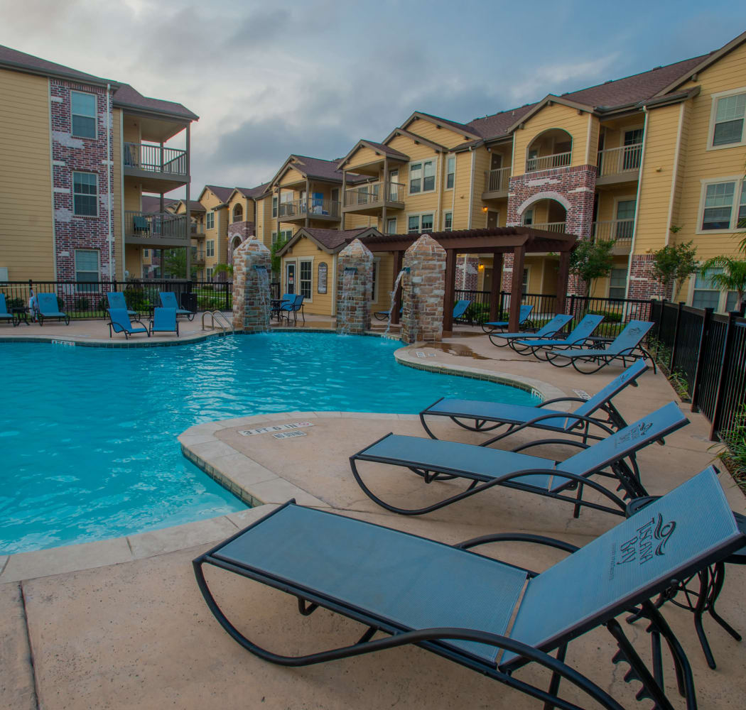 Poolside seating at Tuscana Bay Apartments in Corpus Christi, Texas