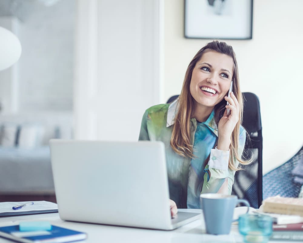 Employee happily answering a phone call at Berkley Properties, LLC in Lakewood, New Jersey