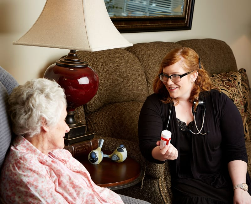 Residents and staff talking about medication at Aurora on France in Edina, Minnesota