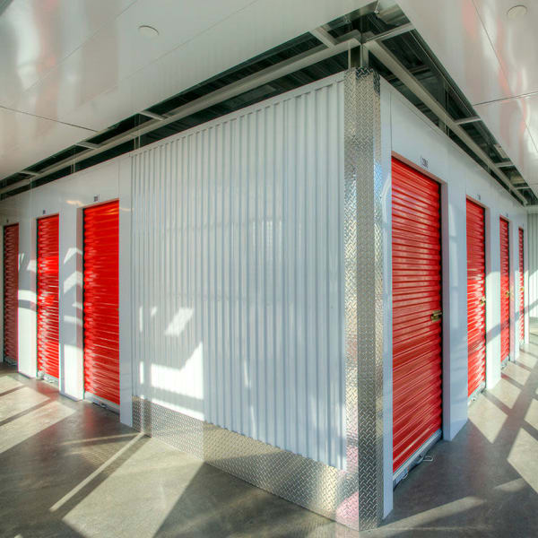 Indoor storage units with bright doors at StorQuest Express - Self Service Storage in Deltona, Florida