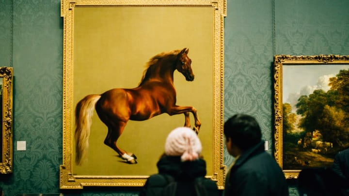 Patrons admiring a painting of a horse at a museum near Sedona Ranch in Odessa, Texas
