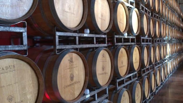 Stacks of wine barrels at Texas Sun Winery near Sundance Creek in Midland, Texas