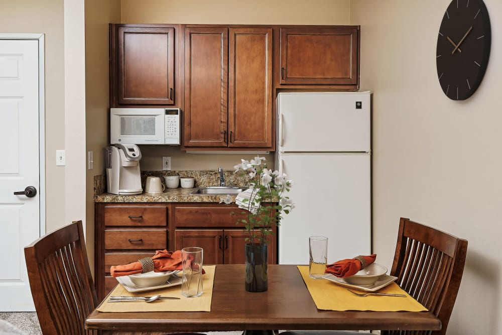 Upscale kitchen with wood accents in senior living apartment at The Springs at Grand Park in Billings, Montana