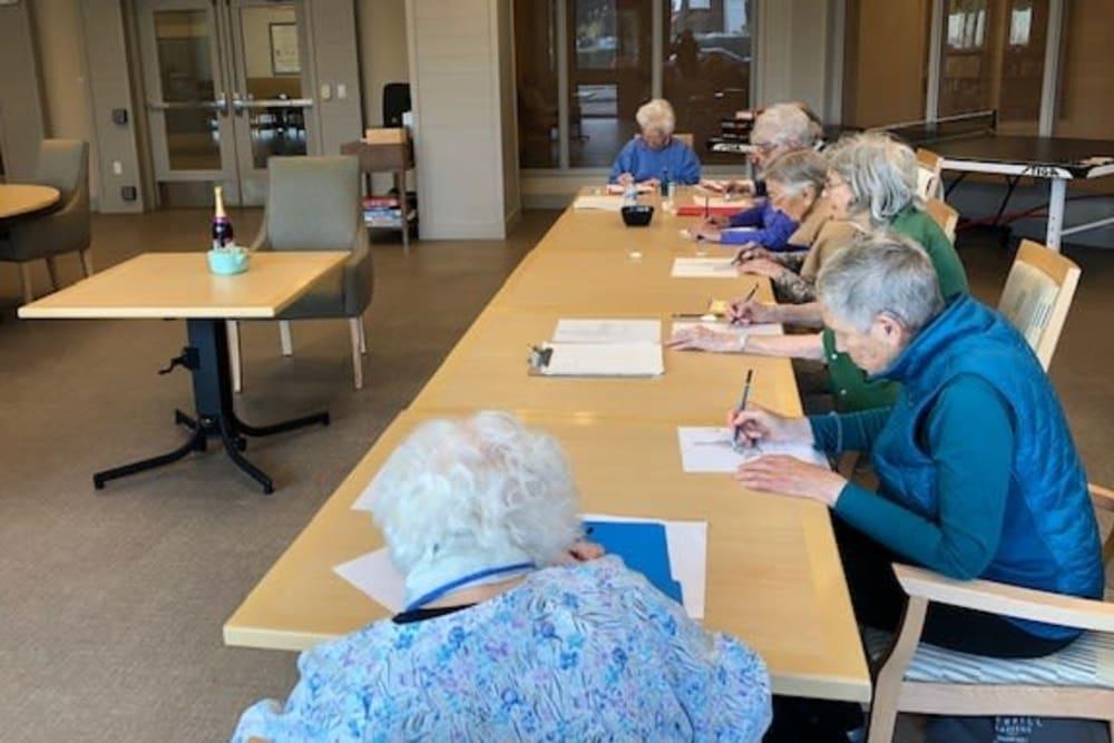 Residents enjoying an advanced art class at Merrill Gardens at Rockridge in Oakland, California