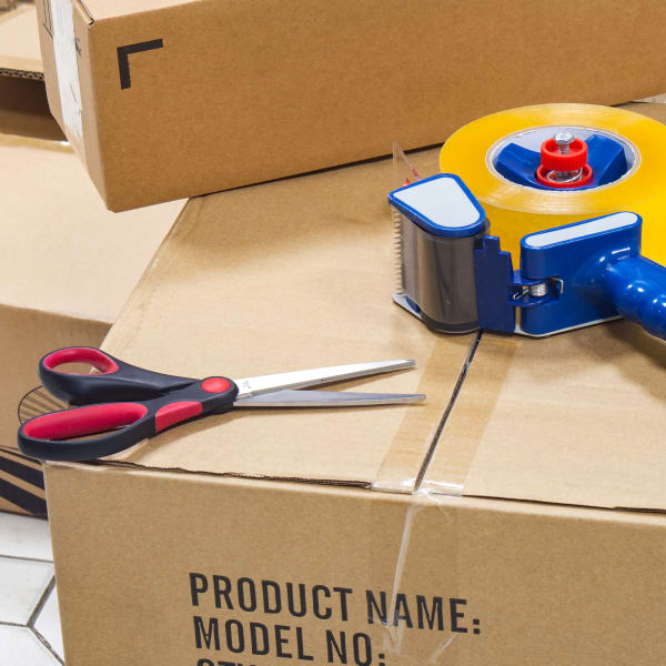 Scissors and tape. Packing supplies are available at Seaport Storage in Tampa, Florida