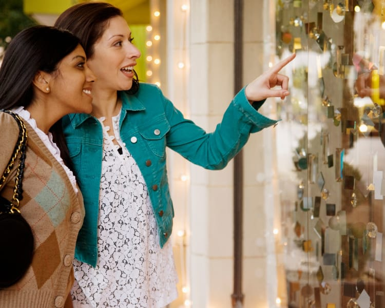 Women looking at an item behind the glass at a shop in Haddon Heights