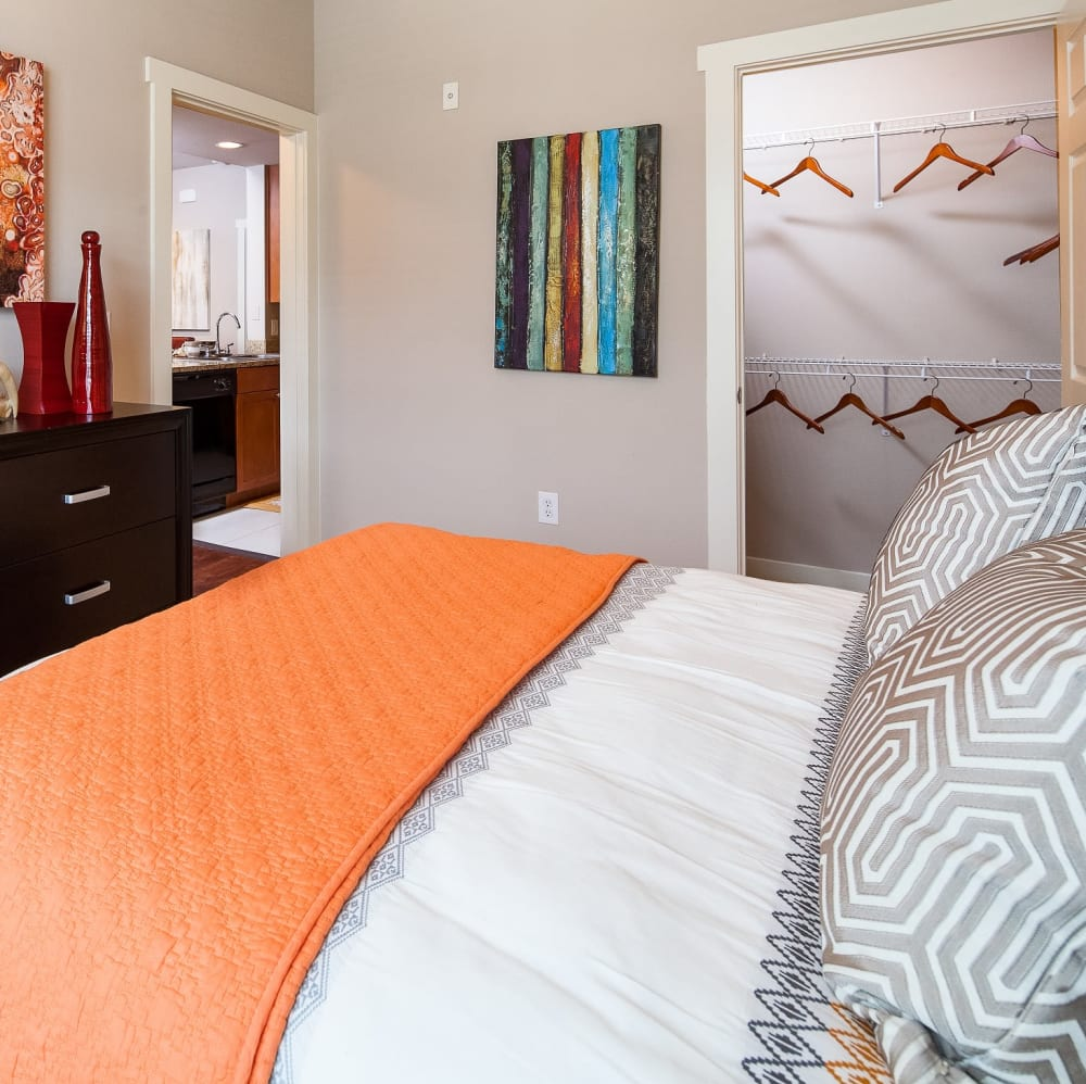 Spacious master bedroom with a walk-in closet at Lakefront Villas in Houston, Texas
