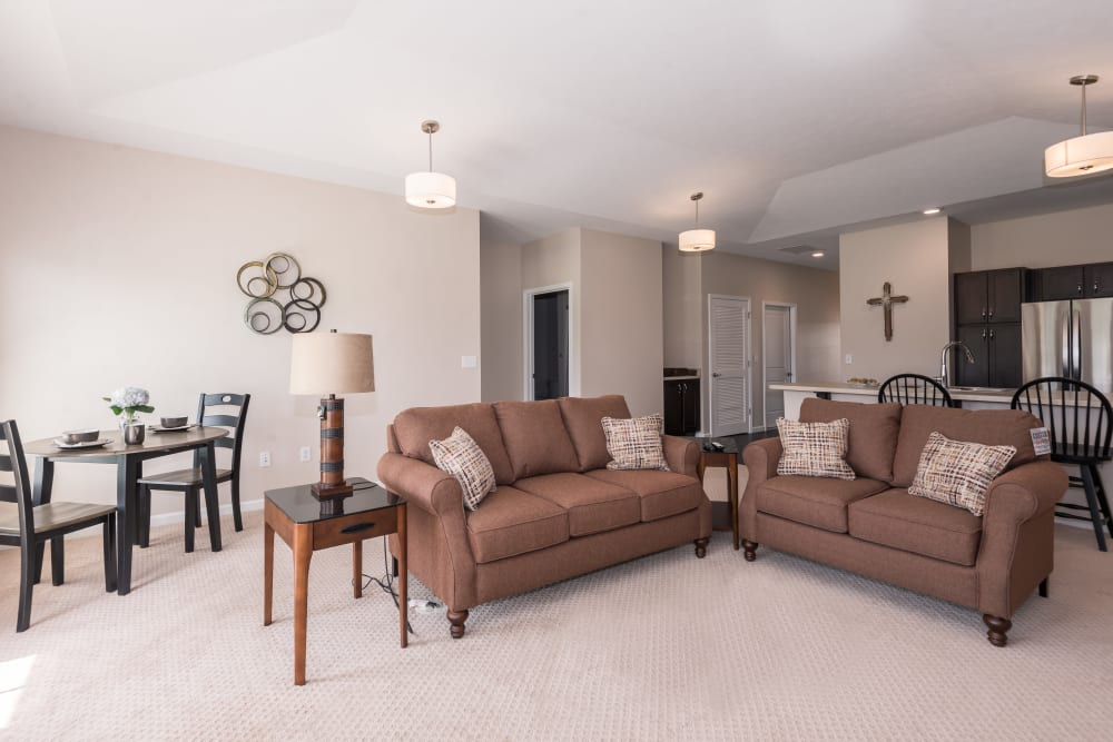 A furnished apartment living room and dining room at Legacy Living Florence in Florence, Kentucky
