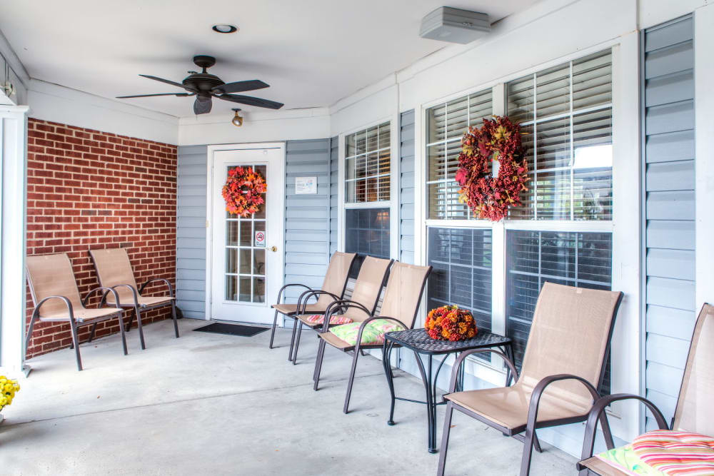 Cheerful porch seating at Carriage Court of Grove City in Grove City, Ohio