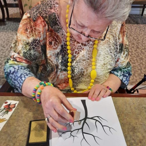 Resident crafting at The Oxford Grand Assisted Living & Memory Care in Wichita, Kansas
