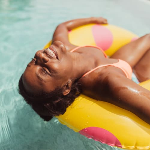 Lounging in the pool at Aspen Pines Apartment Homes in Wilder, Kentucky
