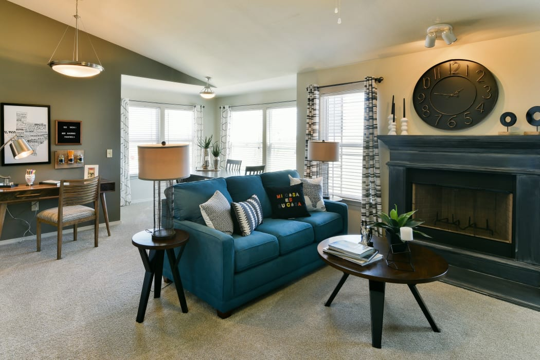 Living room with a fireplace at Cottages at Abbey Glen Apartments in Lubbock, Texas