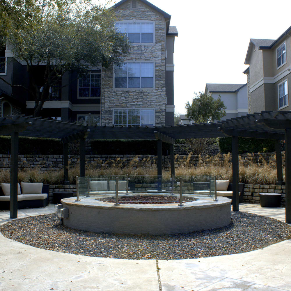 Large outdoor fire pit with comfortable, spacious seating at Beck at Wells Branch in Austin, Texas