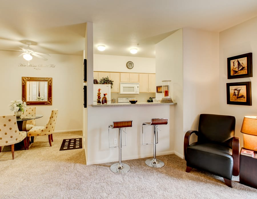 Kitchen with a breakfast bar over looking the living room at The Dakota Apartments in Lacey, Washington